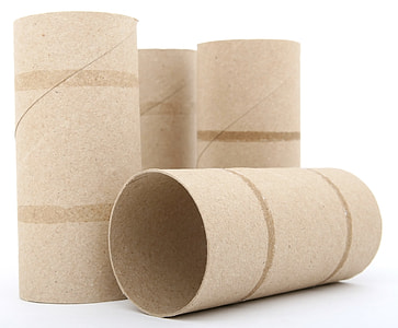 four beige rolled papers