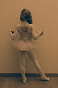 sepia photo of female ballerina