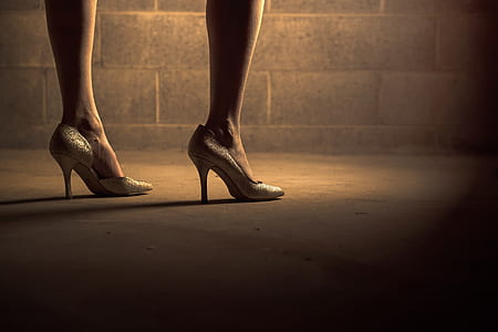 woman in silver pointed-toe heeled shoes
