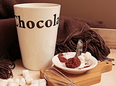 photo of white Chocolate print mug beside spoon with marshmallow on saucer