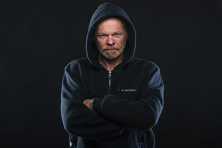 man with black zip-up hoodie photo