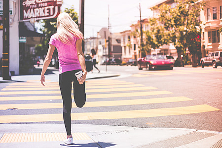 Fit Young Girl Stretching Her Legs Before Jogging Workout