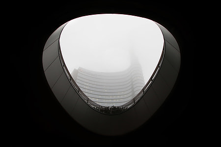 low-angle photography of a concrete high-rise building view from a building balcony view