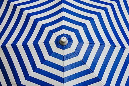 white and blue striped umbrella