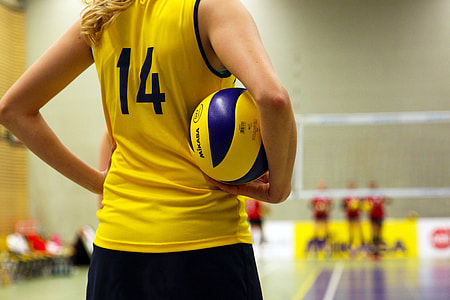 macro shot photography of volleyball player holding ball