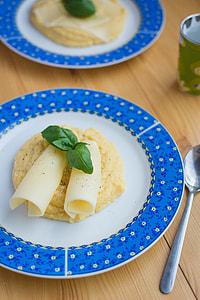 Italian corn polenta with cheese and basil