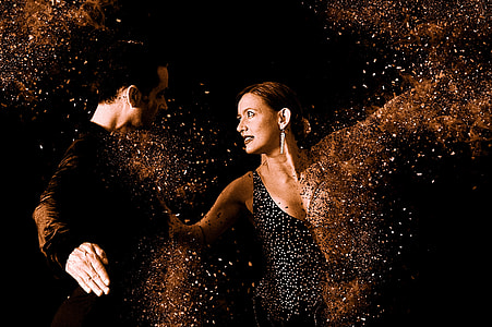 men's black long-sleeved shirt facing woman dancing