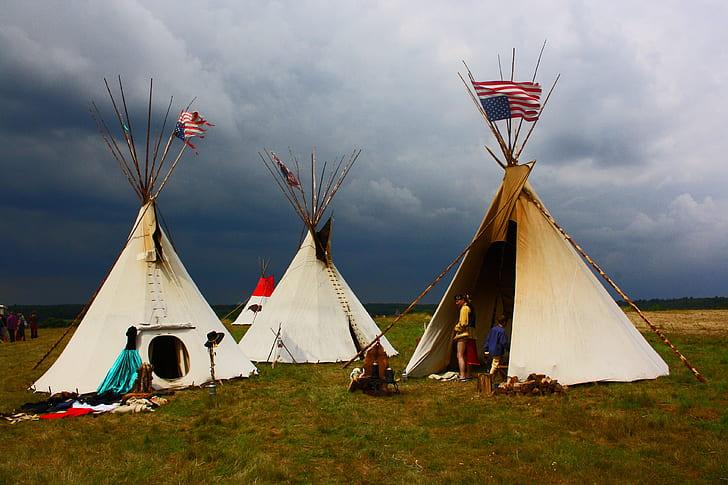 three white Tipi tent with U.S. flag