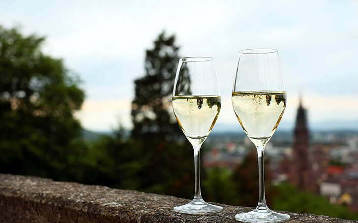 two clear long-stem wine glasses