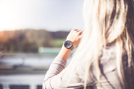 Young Woman with Gray Fashion Watches Enjoying Views