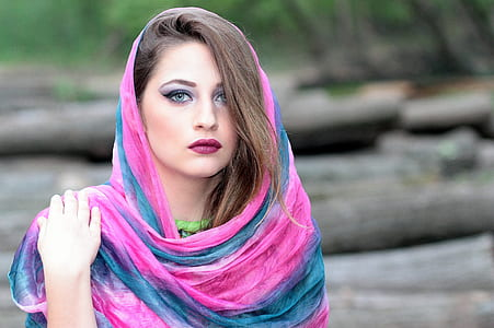 woman wearing teal and pink scarf in tilt shift lens photo