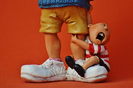 boy hugging man's foot figurine set