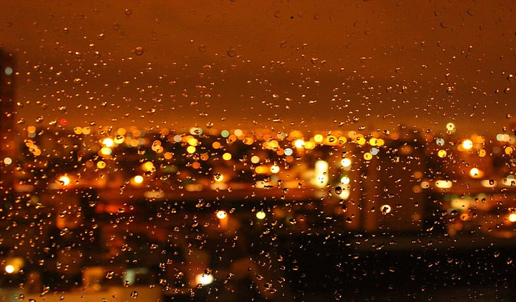 water droplets on clear glass window during night time