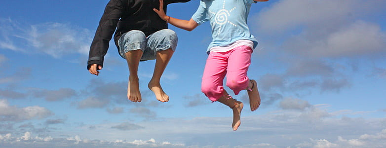 two persons jumping