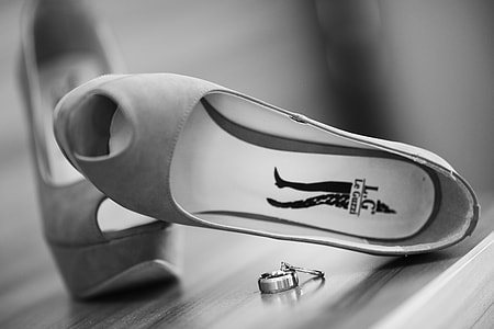 shoes and rings on table