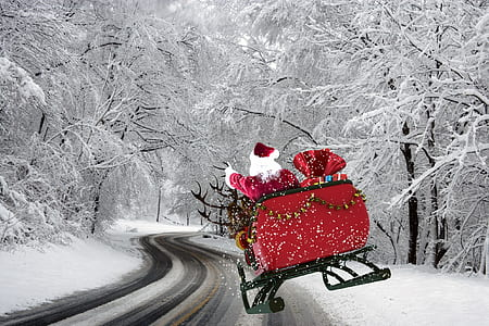 Santa Claus riding on carousel on snow covered trees and road