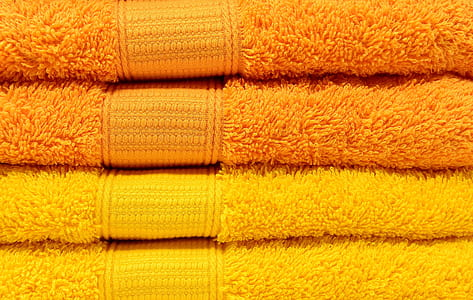closeup photo of two yellow and two orange towels