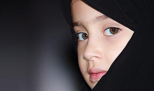girl wearing black hijab headdress