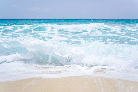 Blue ocean waves on a sandy beach