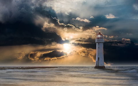 lighthouse in the sea during golden time