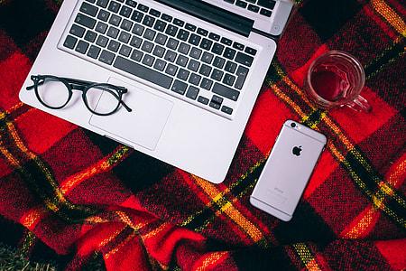 Apple Macbook on a red blanket