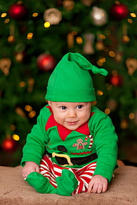 baby wearing green and red elf costume