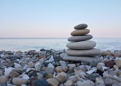cairn stone on sea shore