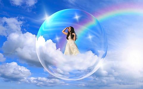 woman in white dress inside bubble