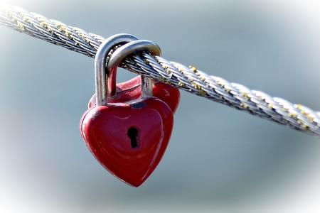 shallow focus red heart padlocks