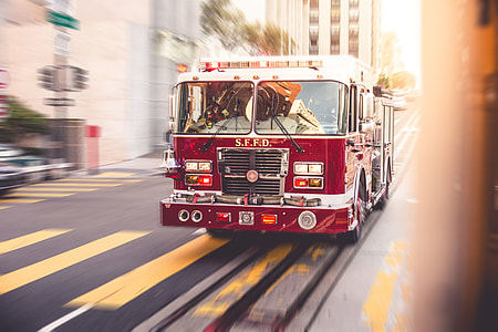 Fire Truck Racing Through The City Traffic