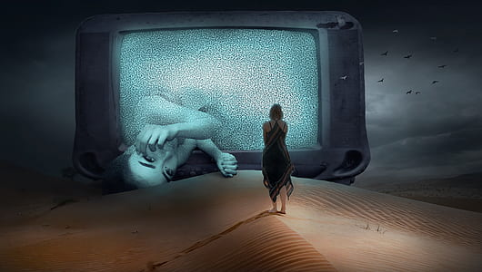 woman standing watching in the giant CRT television