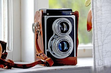 black and brown vintage camera