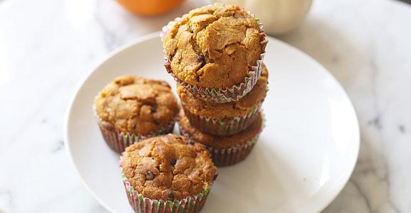 five muffins on white ceramic plate