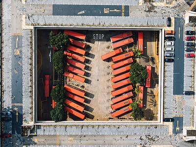 aerial view of orange buses during daytime