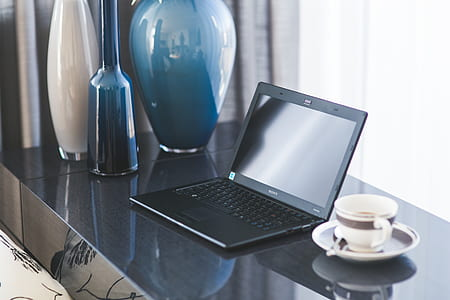 Home office desk with laptop and coffee