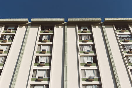 White Painted Residential Building Under Clear Skies