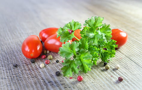 green leafy vegetable and red tomato