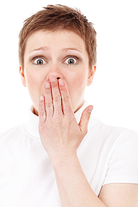 shocking woman and cover her mouth