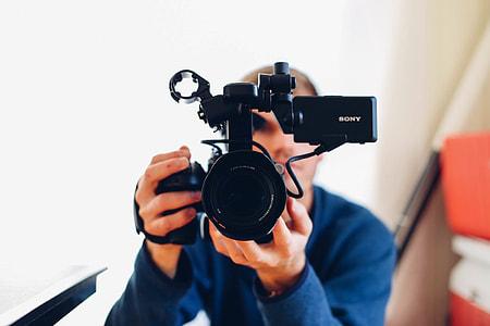 man holding Sony professional video camera