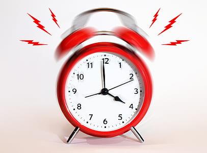 round red alarm clock ringed at 4:00