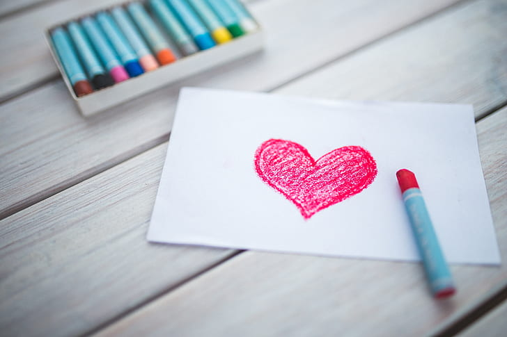 red heart drawing and red crayon