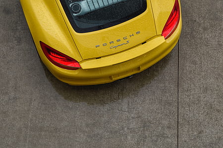 high-angle photography of yellow Porsche coupe
