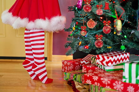 person standing in front of Christmas tree