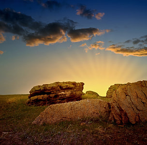creposcular photography of rock formations under cloudy sky
