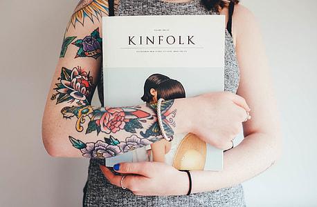 woman holding Kinfolk book