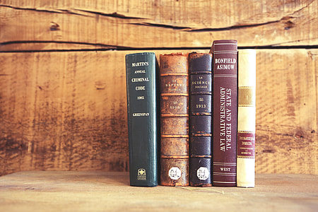 five books on brown surface