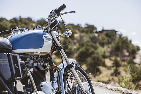 selective focus photography of white standard motorcycle