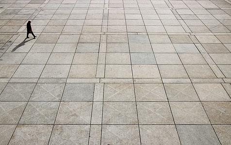 man walking on brown floor