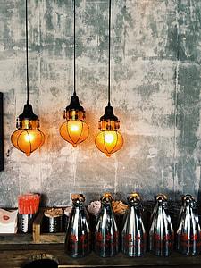 three lighted pendant lamps