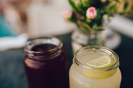 Clear Glass Mason Jar With Lemon Slice on Top of Cocktail